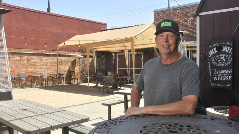 Kevin Lutz sits on patio outside Stoney's Rockin' Rodeo.